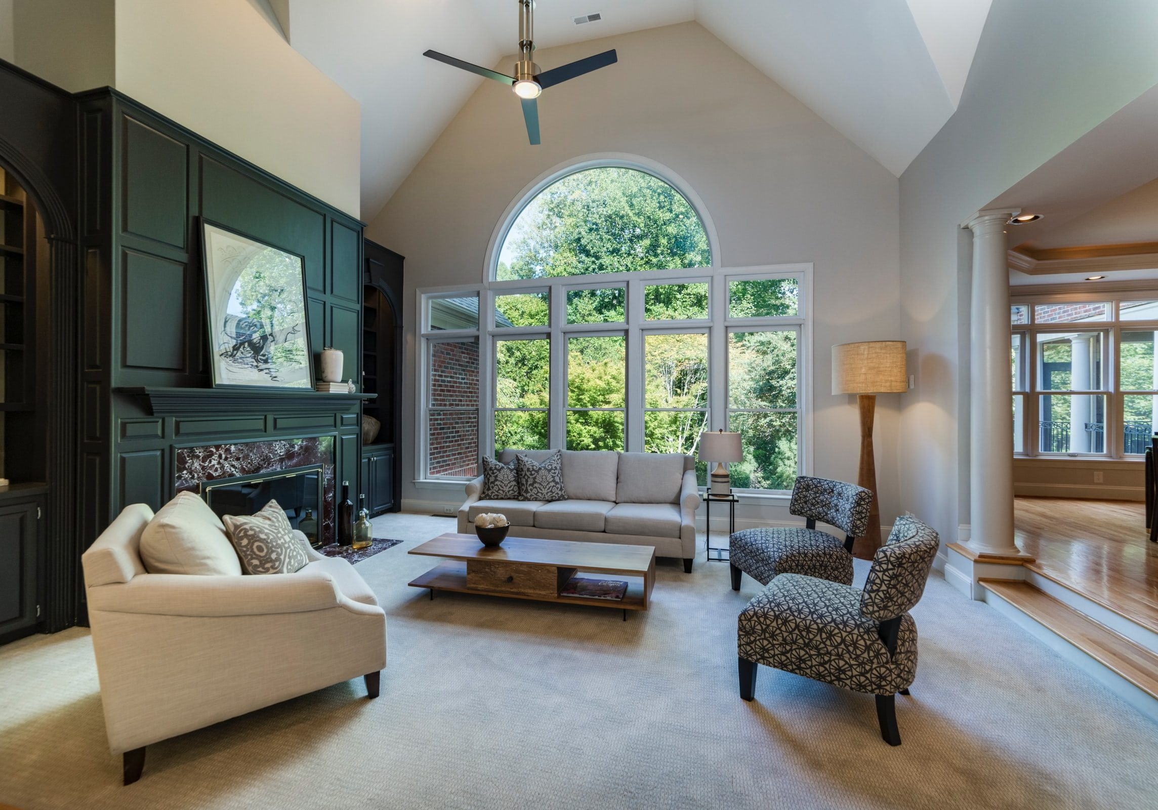 living room with fireplace and big window